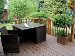 Decking area with outside dining. (Gates are available to create a giant playpen)