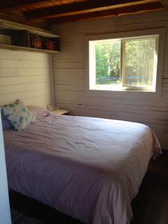 one of 2 main bedrooms on 1st floor