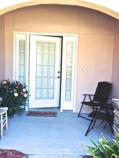 Relaxing front porch; two car garage