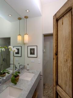 Bedroom 1 Bathroom with double sink vanity shower in back