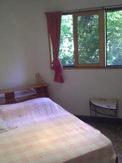 downstairs bedroom. cozy and quiet as not in canopy.