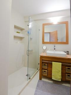 View of bathroom next to third bedroom and kitchen