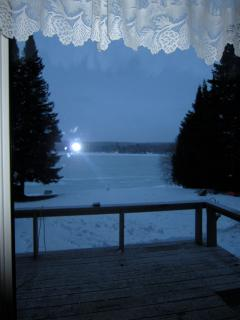early morning sunrise in February- white part is the lake perfect for x-country skiing on