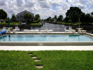 Soak in the florida sun by the pool area overlooking the Rubican Canal