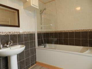 A lovely large bathroom with bath and overhead shower which is for sole use of the Chablis guests