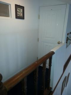 View on entrance door of the Top-guestroom 404/69 on the second floor