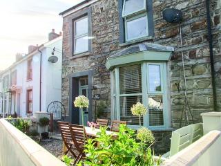 ROSE COTTAGE, end-terrace, open plan living area, front and rear courtyards, in