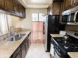 Kitchen with granite counters, stainless appliances including dishwasher, pots, pans etc.