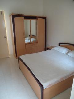 The third bedroom, double bed, wardrobe, balcony and air conditioned