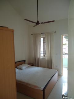 The same bedroom with the balcony door open