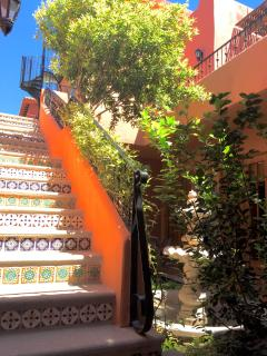 Stairs with Mexican tile detail leads you to the upper levels, sun deck, dining area, tower and more