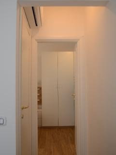 Corridor that goes to the bathroom and the bedroom