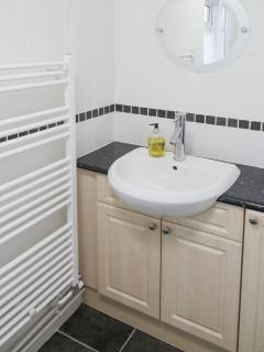 Basin with big radiator next to it.