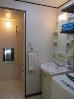 Washing machine, clean towels, shower room with shampoo, hair conditioner & body soap
