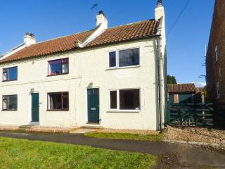 WESLEY COTTAGE, semi-detached, woodburning stove, parking, patio area, in