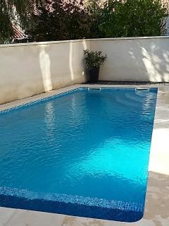 Another view of the pool with corner entry steps