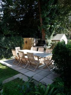 A 4 burner gas BBQ and a lovely sheltered site for outdoor entertaining.