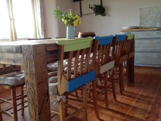 Chapel chairs and a dining table made from reclaimed wood