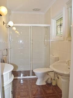 Bathroom with towel heater, shower and toilet