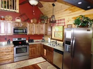 The spacious Kitchen has granite counter tops and stainless steel appliances
