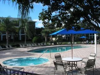 There is a swimming pool and hot tub right next to the condo
