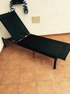 One of four sunloungers