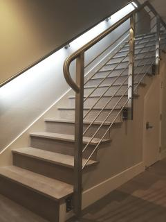 Luxurious features abound, such as LED lighting in the stainless steel handrail.
