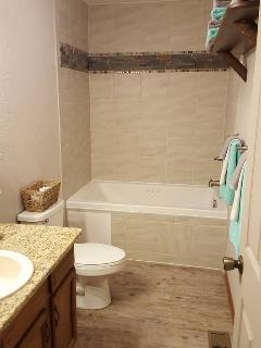 Relax in spacious bathroom with Jacuzzi tub.