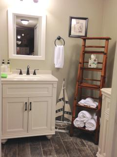 Master bathroom newly renovated with two vanities and a walk in shower