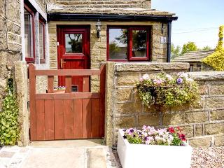 MOORSIDE COTTAGE, stone-built, pet-friendly, woodburner, patio, near Haworth, Re
