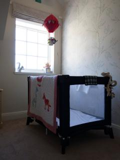 Bedroom two set up with travel cot.