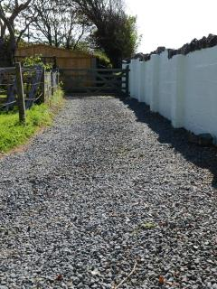 Rear driveway, providing off-street parking, towards double garage and secure garden