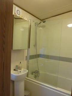 Separate full size ensuite bathroom with shower over