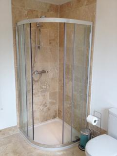 A newly fitted bathroom with separate shower.