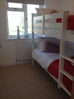 Adult sized bunkbed room with sea views.