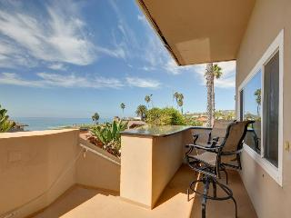 Beach bungalow steps from the ocean & w/ incredible views!