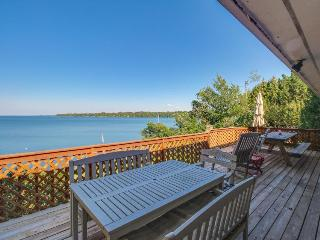 Lakefront property with private hot tub, dock, and views!