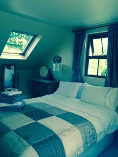 Master bedroom double with velux window views of estuary & beach