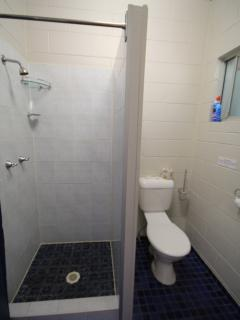 Private detached shower and toilet for each room.