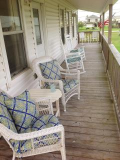Chill out on the front deck in these cushy chairs and rockers, with a gate at the top of the stairs.