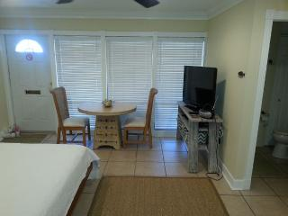 Dining table,40 inch TV with over a 120 stations, Blue Ray/DVD Player and free WIFI.