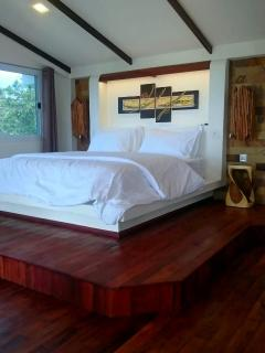 Bedroom with imported solid hardwood flooring