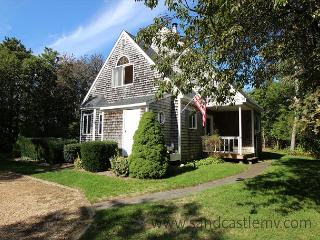 SWEET, CLEAN AND BRIGHT CAPE WITH LOVELY DECK OVERLOOKING GRASSY YARD