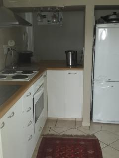 Kitchen with fridge and small freezer