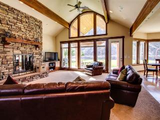 Spacious waterfront home w/ lawn, basketball court, & views of Lake Chelan