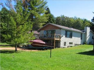 Eagle Bay has a large yard & 150 feet of lake frontage with pier, boat, fire ring, seating