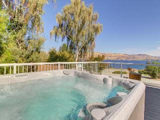Enjoy incredible lake views and a private hot tub from this amazing home, Chelan