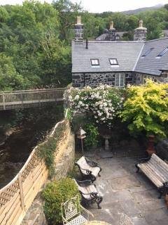 View from master bedroom to the courtyard garden and the river, with Cader Idris in the background