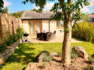 Garden green and lush with well stocked beds. Lots of sunshine Peaceful & Private overlooking fields