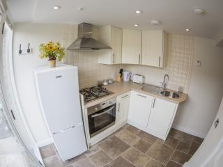 A fully fitted kitchen with dishwasher and microwave.